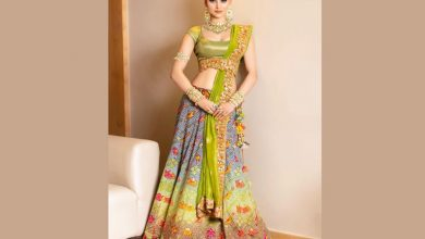 Urvashi Rautela giving traditional vibes in bandhani lehenga from Asha Gautam along with statement jewellery for a recent wedding!